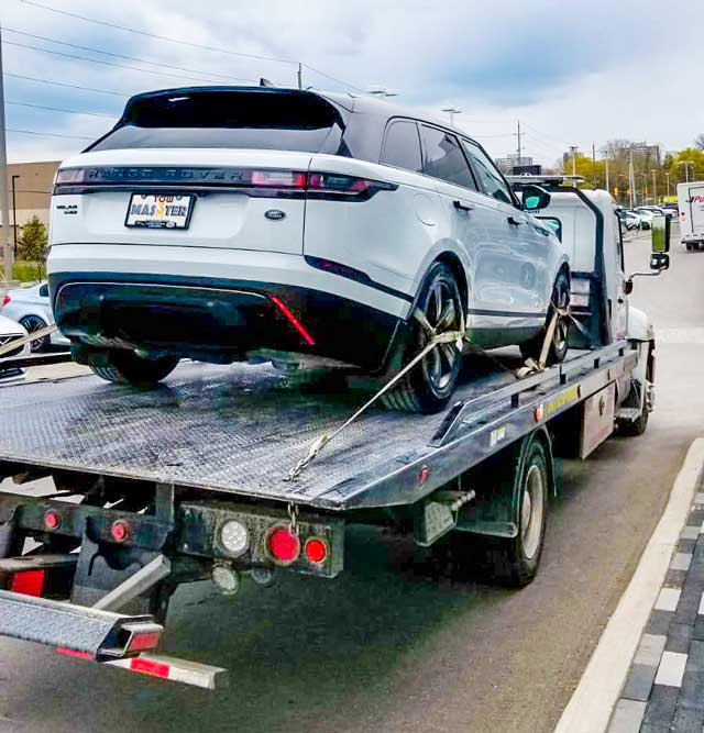 Luxury Vehicle Safe Towing by Tow Master in Downtown Toronto