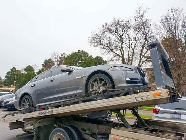 Luxury Vehicle Safe Towing by Tow Master in Pickering