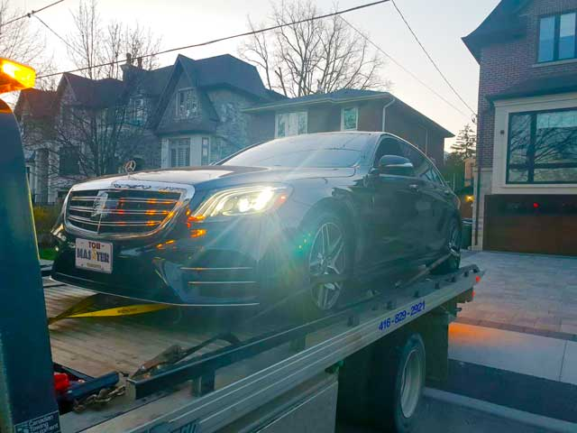 Luxury Vehicle Safe Towing by Tow Master in AJAX