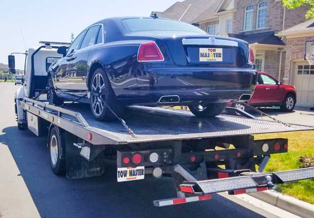Luxury Vehicle Safe Towing by Tow Master from Scarborough