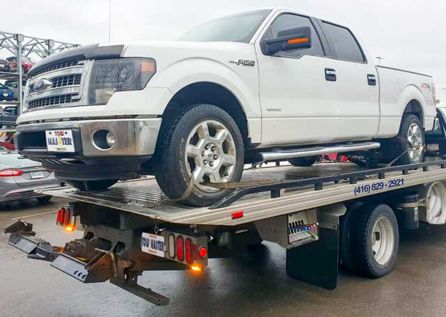 Luxury Vehicle Safe Towing by Tow Master from Downtown Toronto